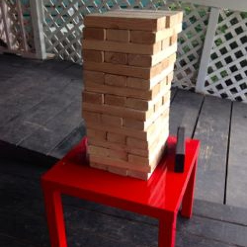 Play a game of Jenga while waiting for your pizza outside Skinny Pig.