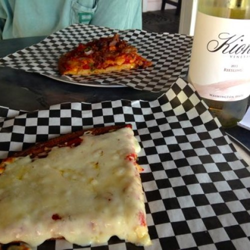 Pizza and wine is a perfect combo.